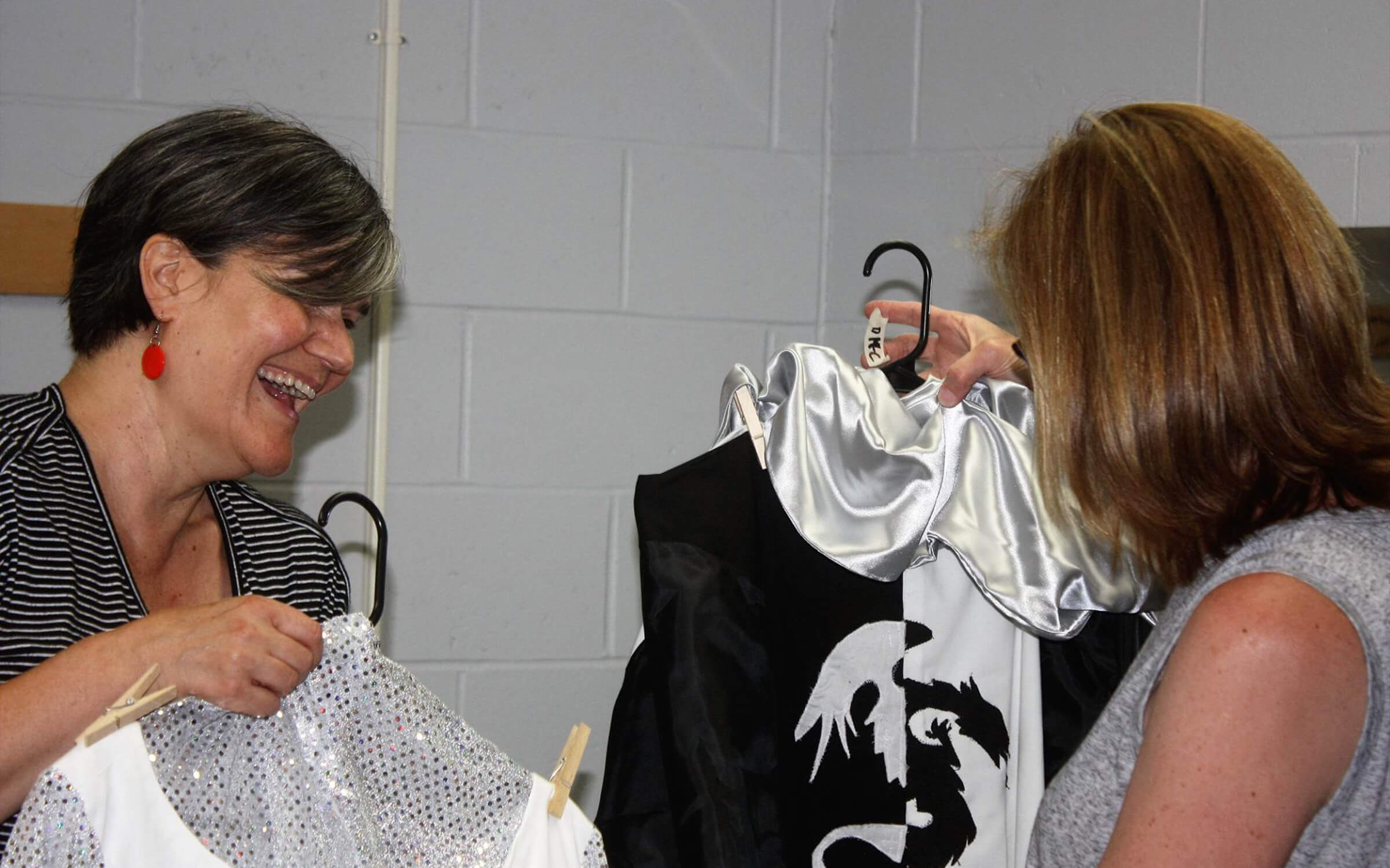 Members looking over costumes