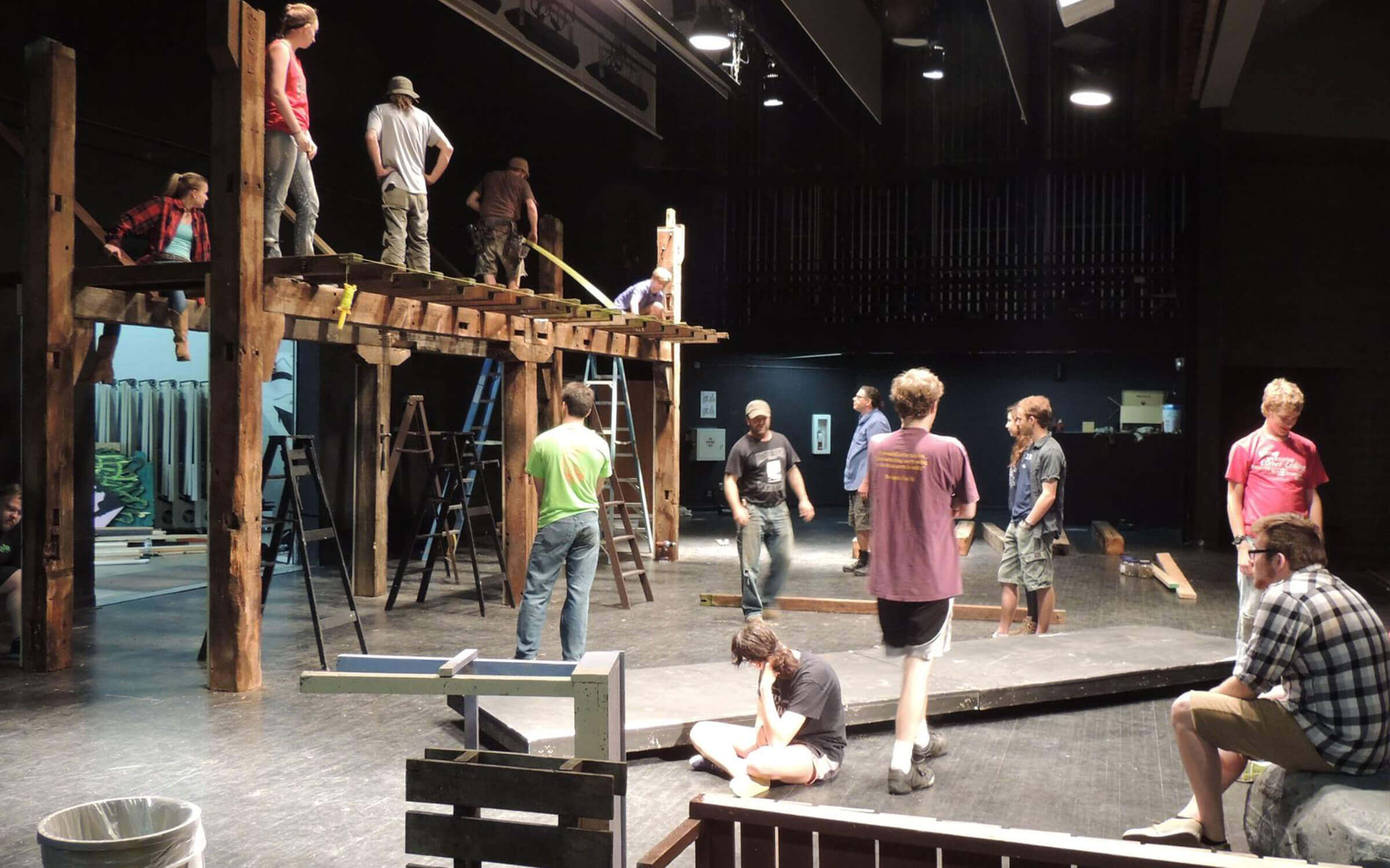 People building Les Miserables set at Decorah High School.