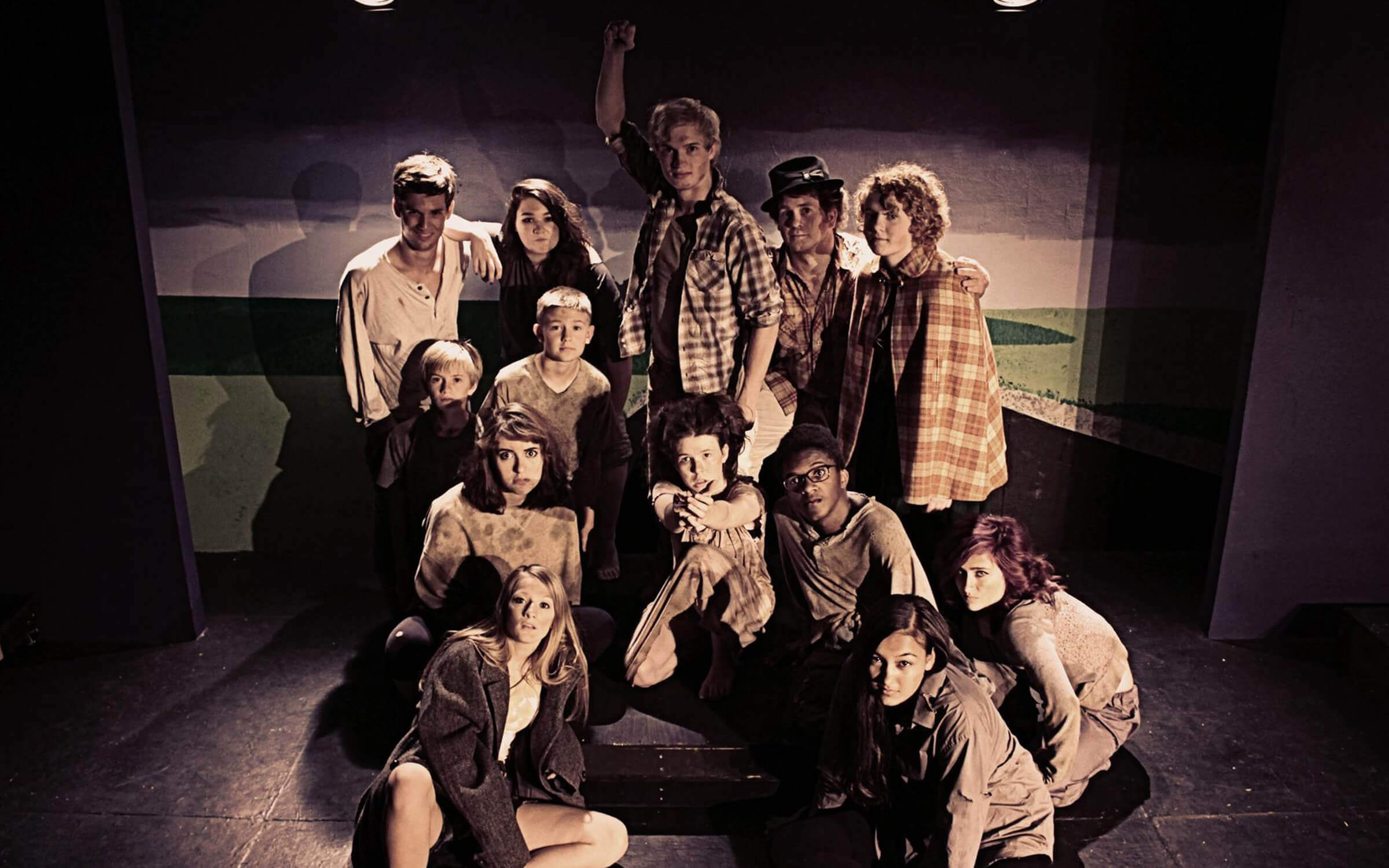 The cast of Urinetown posing for promo photos
